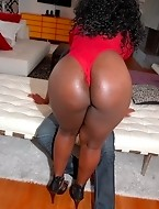 Big black asses girl Selita shows us her truly awesome booty and huge black boobs.